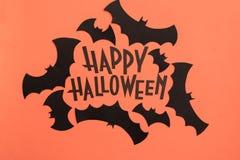 Black logo of Halloween and black bats painted on orange background stock image