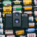 Black Lomo Camera on Top of Photo Films Lot Royalty Free Stock Images