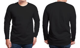 Black Long Sleeved Shirt Design Template. Black long sleeved t-shirt mock up, front and back view, isolated. Male model wear plain black shirt mockup. Long royalty free stock photo