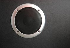 Black loudspeaker. Voice from black loudspeaker with membrane protected by silver circle royalty free stock photography