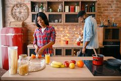 Black love couple cooking romantic dinner stock photo