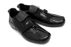 Black low shoes. On a white background Royalty Free Stock Images