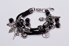 Black lucky charm leather bracelet Royalty Free Stock Image