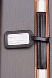 Black Luggage Tag On Baggage Royalty Free Stock Image