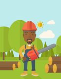 Black Lumberjack cuts a tree by chainsaw Stock Image