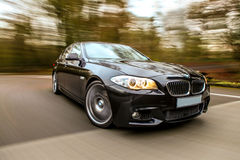 Black Luxury car. Amazing view of black luxury car with heavy blurred motion Royalty Free Stock Photo