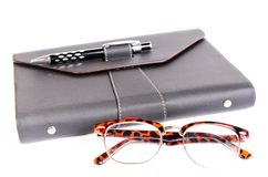 Black luxury organizer and black pen with glasses Stock Photography