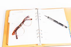 Black luxury organizer and black pen with glasses Royalty Free Stock Photo
