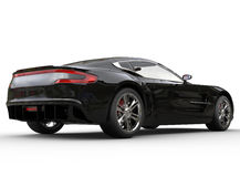 Black luxury sports car on white background - tail view Royalty Free Stock Photos