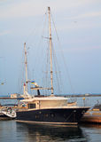 Black luxury yacht at the dock Stock Photography