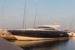 Black luxury yacht at the dock Stock Photos