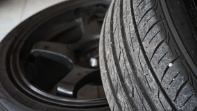 Black mag and tire. Place on the floor Stock Photos