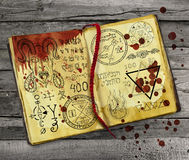 Black magic book with mystic symbols and bloody drops Stock Images