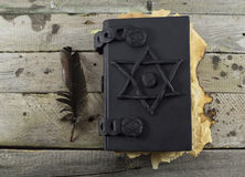 Black magic book on the planks 1 Stock Photos