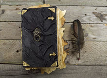 Black magic book on the planks 2 Royalty Free Stock Photo
