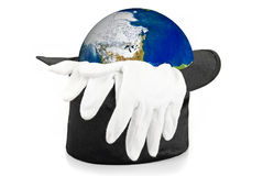 Black magic hat and gloves with earth Stock Images
