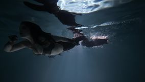 Black Mermaid Underwater Girl with Tail. Black Magic Mermaid in Underwater Video with Beauty Tail stock footage