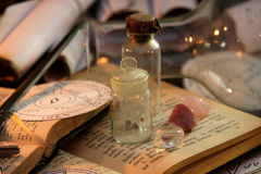 Black Magic Ritual. Antique Magic Book. Witchcraft  background. Candle and alchemy ingredients around Stock Photo