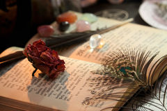 Black Magic Ritual. Antique Magic Book. Witchcraft  background. Candle and alchemy ingredients around Stock Photography