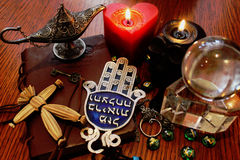 Black magic ritual objects. Black magic ritual occult and esoteric symbols, objects. Black burning  skull and red heart  candles, magic Aladdin lamp, pendulum Stock Photography