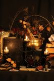 Black Magic Spells. Wiccan spells. Still life Witchcraft composition with candles, crystal, magic book and pentagram symbol. Halloween and occult concept, black Stock Photos