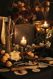 Black Magic Spells. Wiccan spells. Still life Witchcraft composition with candles, crystal, magic book and pentagram symbol. Halloween and occult concept, black Stock Photo