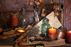 Black Magic Spells. Wiccan spells. Still life Witchcraft composition with candles, crystal, magic book and pentagram symbol. Halloween and occult concept, black Royalty Free Stock Photos