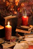 Black Magic Spells. Wiccan spells. Still life Witchcraft composition with candles, crystal, magic book and pentagram symbol. Halloween and occult concept, black Royalty Free Stock Images