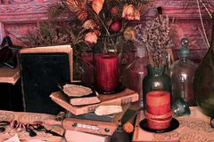 Black Magic Spells. Wiccan spells. Still life Witchcraft composition with candles, crystal, magic book and pentagram symbol. Halloween and occult concept, black Stock Images