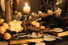 Black Magic Spells. Wiccan spells. Still life Witchcraft composition with candles, crystal, magic book and pentagram symbol. Halloween and occult concept, black Royalty Free Stock Photography