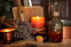Black Magic Spells. Wiccan spells. Still life Witchcraft composition with candles, crystal, magic book and pentagram symbol. Halloween and occult concept, black Royalty Free Stock Image