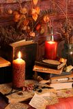 Black Magic Spells. Wiccan spells. Still life Witchcraft composition with candles, crystal, magic book and pentagram symbol. Halloween and occult concept, black Royalty Free Stock Photo