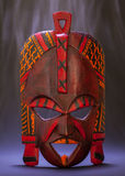 Black Magic. Tradional mask from Kenya (made of wood) with smoke effect useful for concepts Royalty Free Stock Photo
