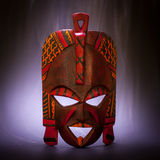 Black Magic. Tradional mask from Kenya (made of wood) with smoke effect useful for concepts Stock Photography