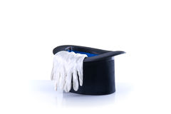 Black magician top hat with a pair of white gloves Stock Photo