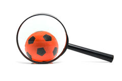 Black magnifying glass with soccer ball Stock Photos