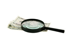 Black magnifying lens and dollars isolated Stock Photo