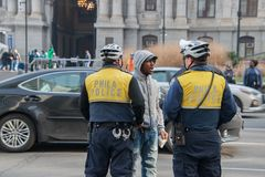 Black male arguing with Philadelphia police officers stock photography