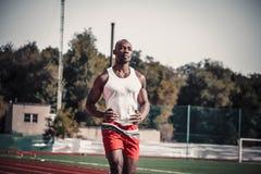 Black male athlete makes a light run Royalty Free Stock Photos