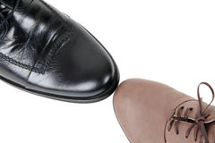 Black male and brown female shoes. Black male shoe and brown female shoe isolated on white Stock Images