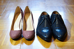 Black male and brown female shoes Stock Photos