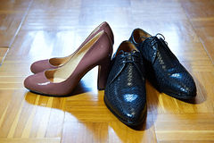Black male and brown female shoes Royalty Free Stock Photo