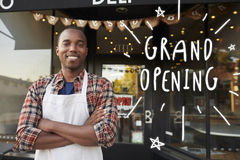 Black male business owner outside coffee shop grand opening stock image