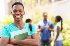 Black male college student. Portrait of black male college student holding books Royalty Free Stock Images
