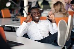 Black Male Designer Working At Desk In Modern Office