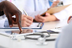 Black male doctor hand point in digital tablet pc. Black male medicine doctor hand point with finger in digital tablet pc touch screen closeup. Human interaction Stock Photo