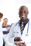 Black male doctor point with finger in digital tablet pc Stock Images