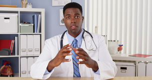 Black male doctor talking to camera Royalty Free Stock Photos