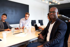 Black male executive facing camera during meeting Stock Image