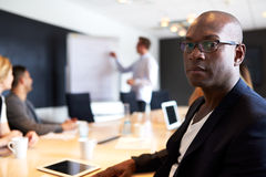 Black male executive facing camera with serious expression Royalty Free Stock Photo